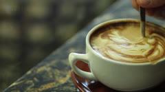 Stirring Latte in Coffee Shop Stock Footage