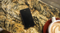 Cell phone in a coffee shop Stock Footage