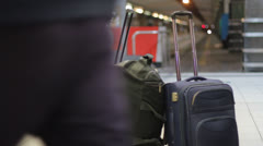 Unclaimed luggage at train station Stock Footage