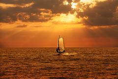 Windsurfer sailing in the sea Stock Photos