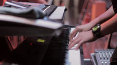 Keyboard player performing on stage. - stock footage