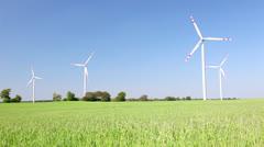 Windmills and green grain field Stock Footage