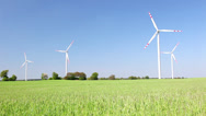 Windmills and green grain field Stock Footage