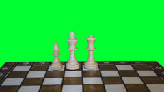 Chess figures form on chess board and prepare to battle on greenscreen backgroun - stock footage