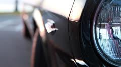 Headlight and side of Mustang b, rackfocus series Stock Footage