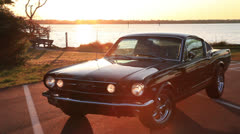 Mustang at waterway sunset, 100% Stock Footage