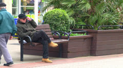 Man Sat on Street Bench Stock Footage