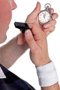 referee checking stopwatch - stock photo
