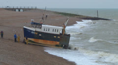 Fishing Boat Pulled on to Beach Stock Footage