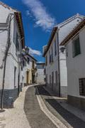 narrow albaicin street - stock photo