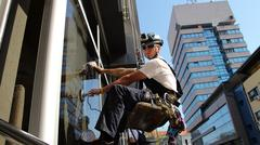 Window Washers on a Office Building Stock Photos