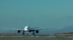 The passenger plane taxis on a concrete path for running start and take-off Stock Footage