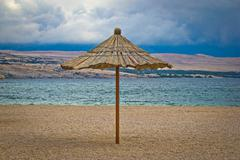 Famous zrce beach umbrella out of season Stock Photos