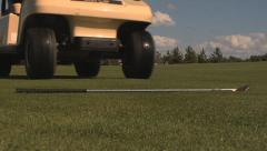 Golf cart drives over club sequence - stock footage