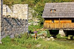 old church ruins & watermill on gacka - stock photo