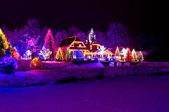 Christmas fantasy - park, forest & lodge in xmas lights Stock Photos