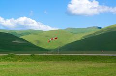 Wind-sleeve on green plateau in mountains in Italy Stock Photos