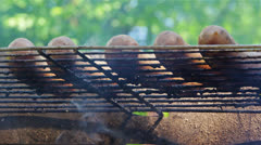 Turning around sausages on grill. Stock Footage