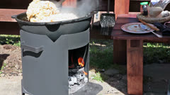 Open fire stove for food cooking Stock Footage