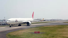 JAL company aircraft riding to the runway, Japan Stock Footage