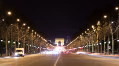 Arc de triomphe at night with traffic Stock Footage