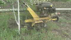 Cultivator assistant gardener and farmer Stock Footage