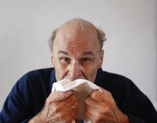 senior with influenza - stock photo