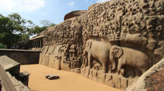 India Tamil Nadu Mahabalipuram Arjuna's Penance relief sculpture wall 2 - stock footage