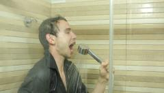 Funny man singing in shower Stock Footage