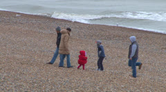 Family Walking on Shale Beach Stock Footage
