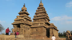 India Tamil Nadu Mahabalipuram Shore Temple visitors and twin gopurams 3 Stock Footage
