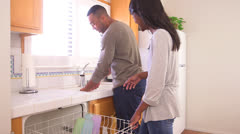 Black couple doing the dishes Stock Footage