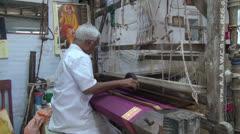 India Tamil Nadu Kanchipuram loom weaving purple fabric 2 Stock Footage