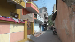 India Tamil Nadu Kanchipuram balconies and pastel walls in alley Stock Footage
