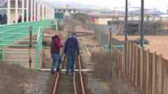People on Railway Tracks Stock Footage
