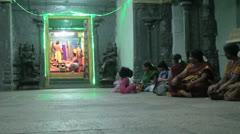 India Tamil Nadu Kanchipuram temple seated people and colorful shrine 4 Stock Footage