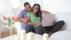 Stock Video Footage of Cute black couple using a laptop in living room