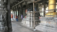 Stock Video Footage of India Tamil Nadu Kanchipuram temple with cow and people in robes 1