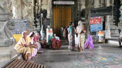 India Tamil Nadu Kanchipuram pilgrims sit on floor of temple 3 Stock Footage