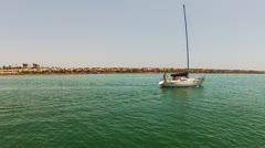 POV Passing Sailboat Leaving Alamitos Harbor Bay Stock Footage