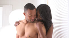 Black couple being intimate Stock Footage