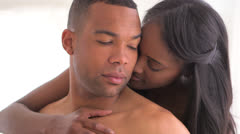 Sweet black couple being intimate - stock footage