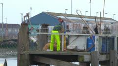 Fishermen on Dock Stock Footage