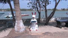 India Tamil Nadu lakeside rabbit sculpture trash can Stock Footage