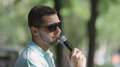Man speaks into a microphone Stock Footage