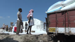 India Tamil Nadu salt pile and carrying sacks to truck 1 Stock Footage