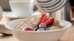Milk on cereal for breakfast Stock Footage