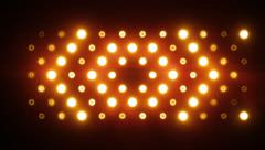 Stock Video Footage of Bright Floodlights Flashing forming figures with sound. Amber. Shapes 3.