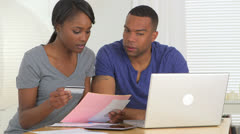 Black couple paying their bills Stock Footage