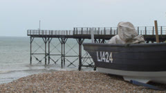 Beached Boat and Pier Stock Footage